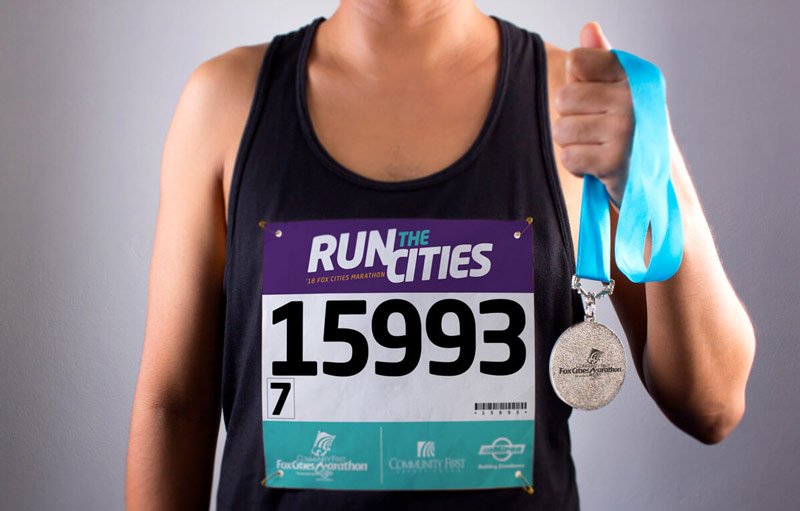 Run the Cities runner with number and medal