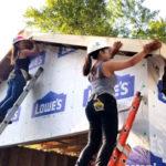 designIQ volunteers working on roof