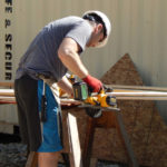 designIQ volunteer working with skill saw