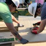 designIQ volunteers using skill saw