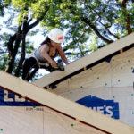designIQ volunteer working on roof